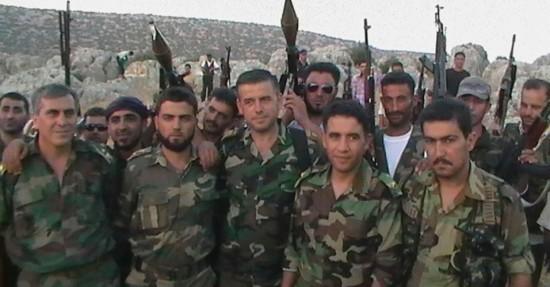 8jul2012---soldados-que-desertaram-do-exercito-sirio-se-juntam-as-forcas-rebeldes-1341746181576_956x500