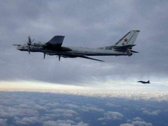 An-F-A-18-Hornet-escorts-a-Russian-Tu-95-Bear-long-range-bomber-aircraft