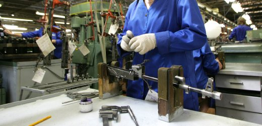 A worker assembles an automatic rifle at the Izhmash firearms factory in Izhevsk